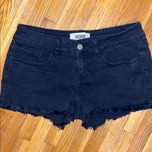 Black jean shorts.